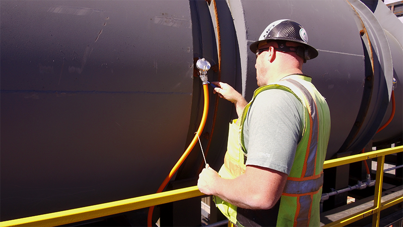 Worker Inspects Kiln During Service Visit